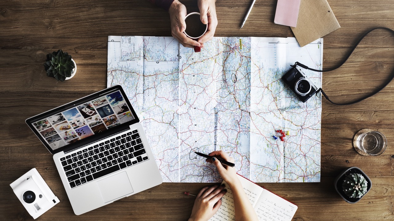 map, laptop, looking at destination