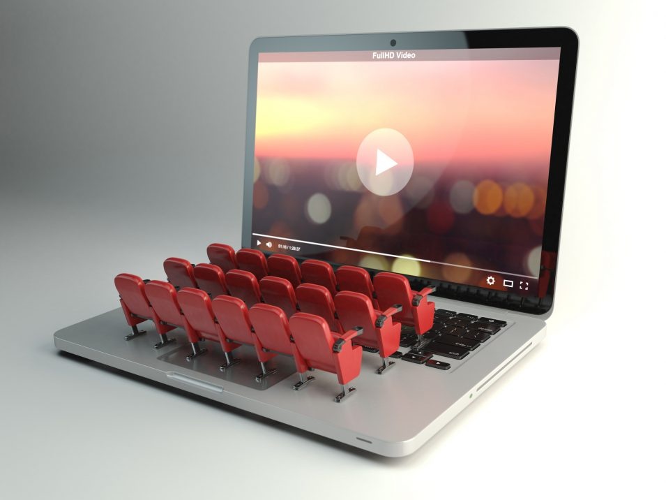 Rows of theater chairs on a laptop computer