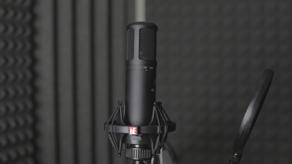 Microphone in a studio with pop screen