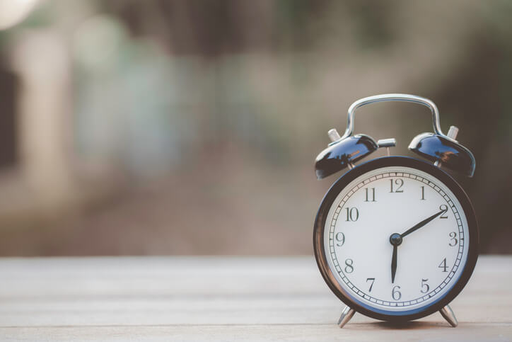 photo-of-a-clock-on-a-table