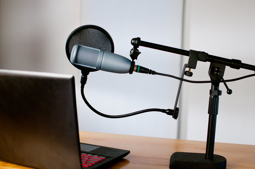 laptop with microphone and pop filter