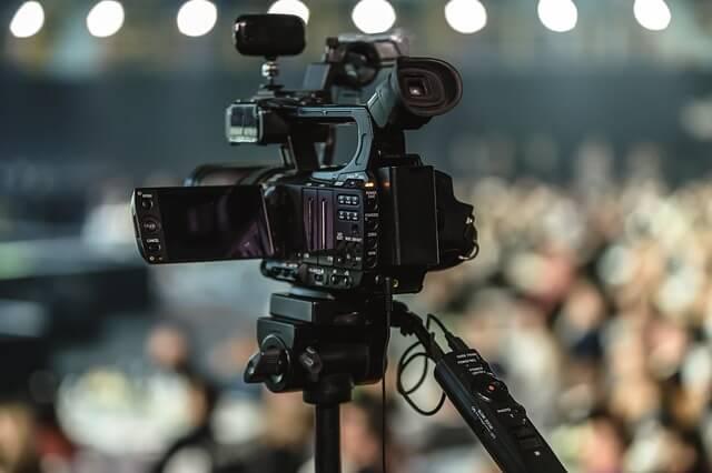 photo of a camera on a tripod, ready to record