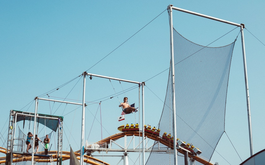 Trapeze artist practices in the rig.