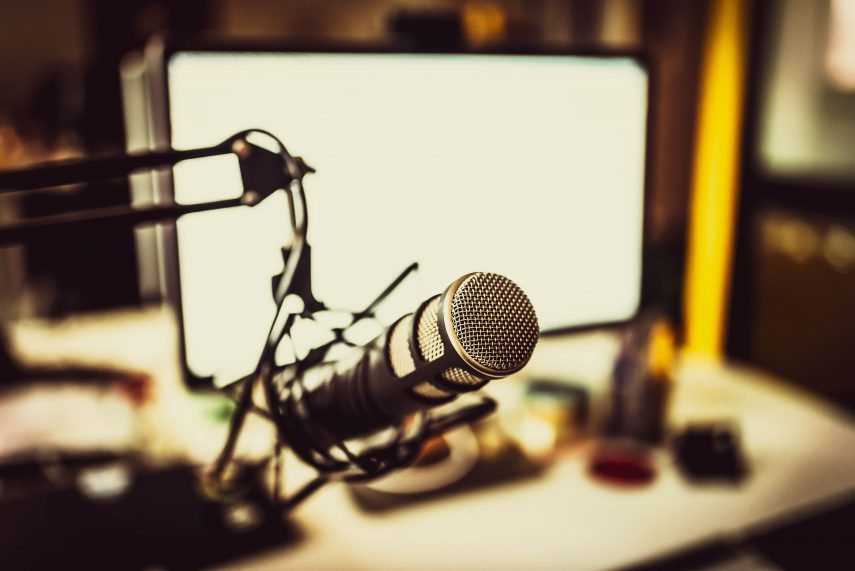 photo of home studio set up with microphone and computer screen