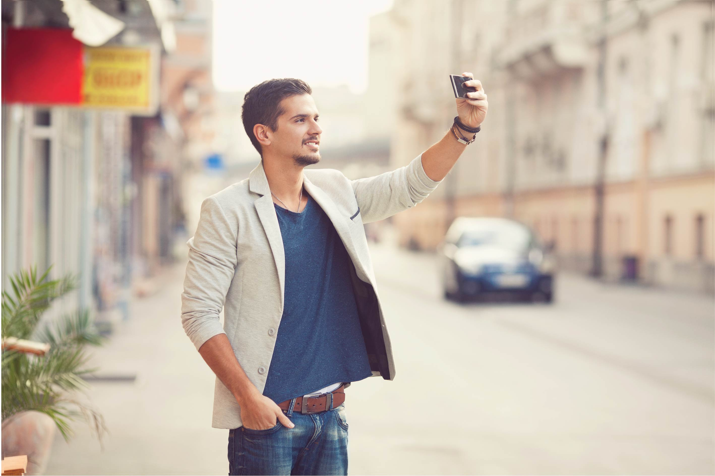 A professional-looking man scouting a location while taking a picture