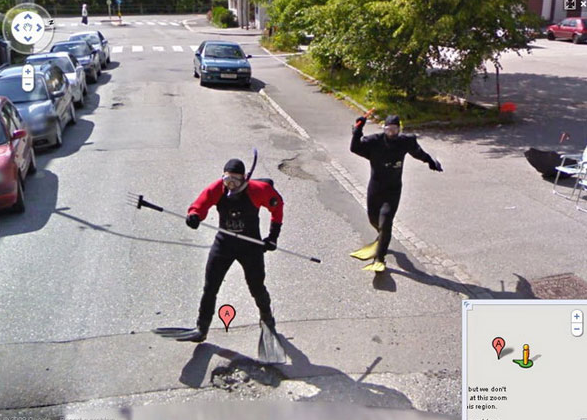 Google Maps camera car photo of two people wearing scuba suits in pursuit of the cam-car