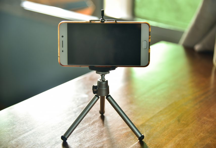 mobile phone on tripod to record video