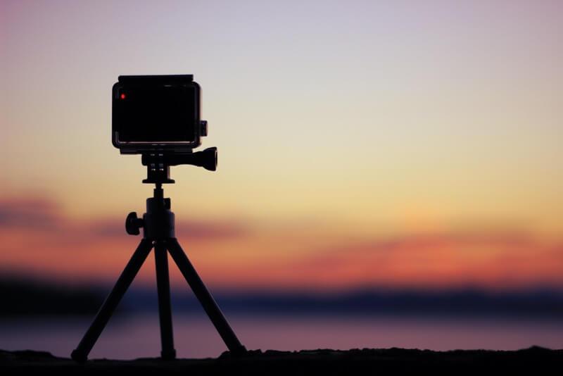 Tripod with GoPro Camera at sunset