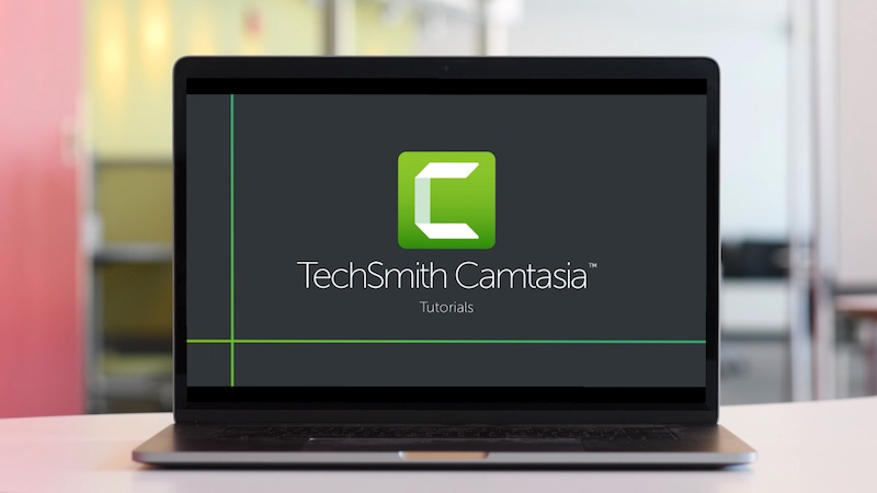 Computer with TechSmith Camtasia tutorials on the screen