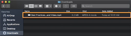 The Mac Downloads folder with an orange box around the downloaded MP4 file